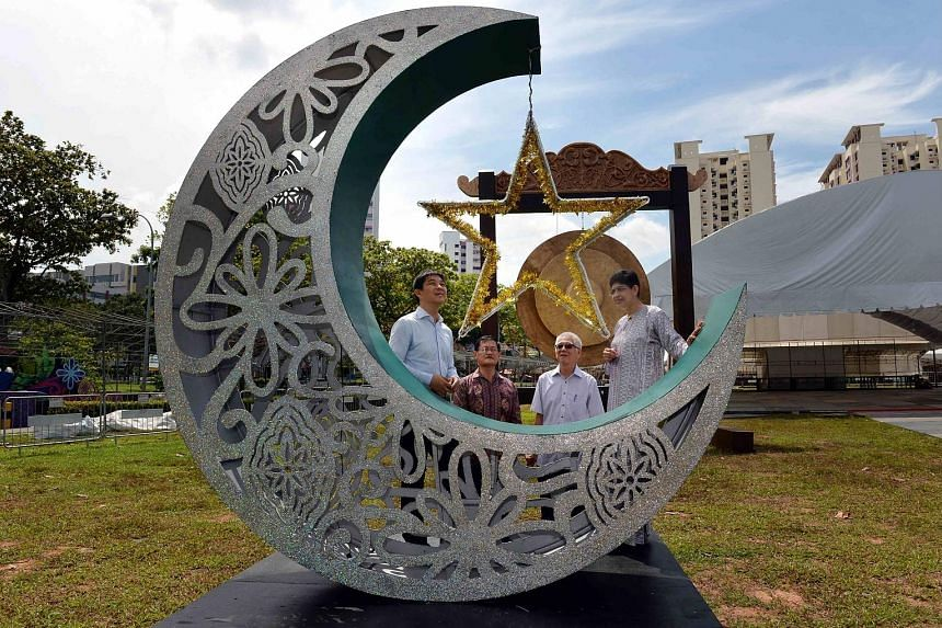 Members of the Hari Raya light-up committee include (from left) Mr Tan, Mr Eric Wong, chairman of Geylang Serai Citizens' Consultative Committee, Dr Teo Cheng Swee, chairman of Kembangan-Chai Chee CCC, and Dr Fatimah.