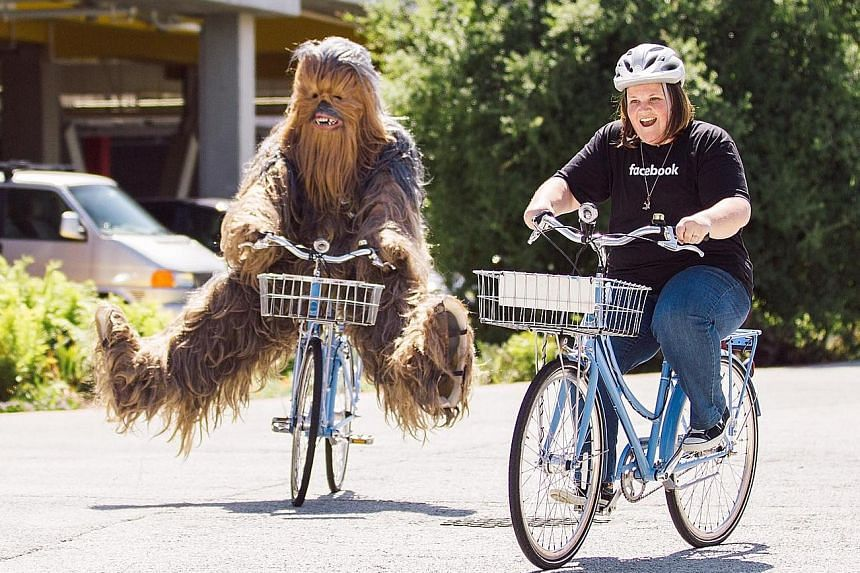 Ms Payne (right) enjoyed bike rides and coffee with 'Chewbacca' at Facebook HQ days after she uploaded a video of herself laughing hysterically while wearing an electronic mask of the Star Wars character.