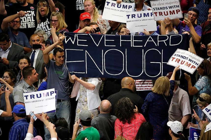 Protesters disrupting a rally by Republican presidential candidate Donald Trump and his supporters in Albuquerque, New Mexico, on Tuesday. The protesters threw stones at police horses and lit fires, according to the police and postings on social medi