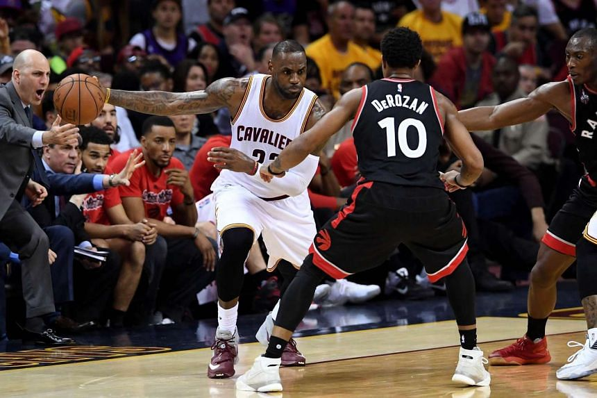 LeBron James #23 of the Cleveland Cavaliers handles the ball in the second half against DeMar DeRozan #10 of the Toronto Raptors.