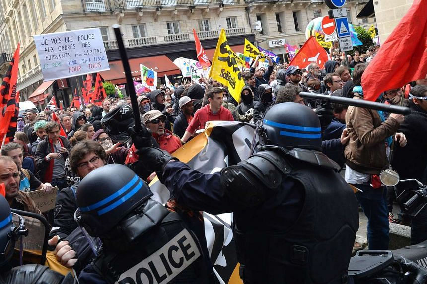 Security forces clash with demonstrators during a protest in Bordeaux, south-west France.