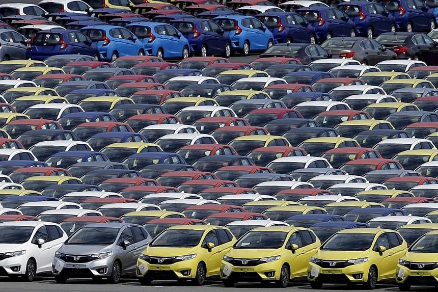 Newly manufactured cars of the automobile maker Honda await export at port in Yokohama, Japan.