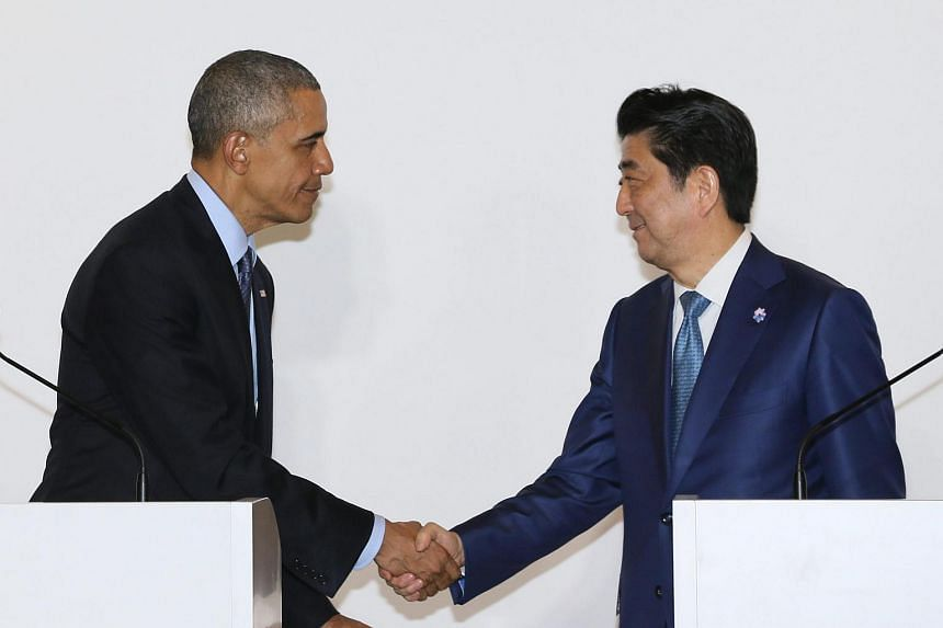US President Barack Obama (left) and Japanese Prime Minister Shinzo Abe shake hands at the end of a joint press conference after a bilateral meeting in Shima, Japan, on May 25, 2016.