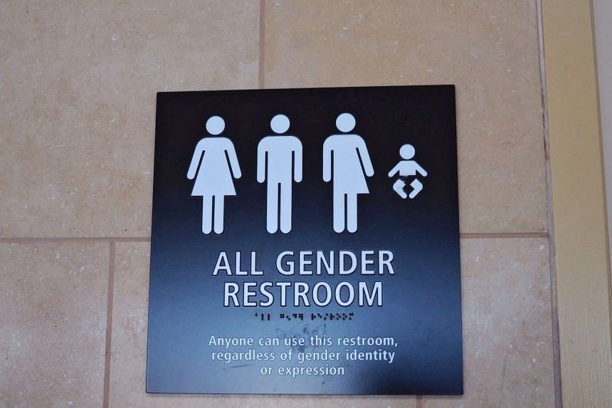 """An """"All Gender"""" bathroom sign at San Diego International Airport in the US."""