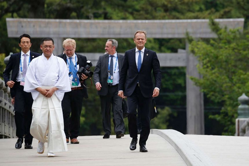 European Council President Donald Tusk (right) walks on Ujibashi bridge on the first day of the G7 leaders summit.