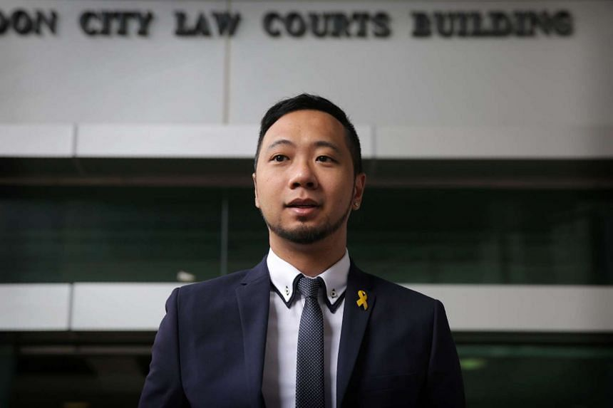 Ken Tsang stands outside Kowloon City Court where he is appearing on assault charges for allegedly splashing liquid on police officers during mass street rallies in 2014.