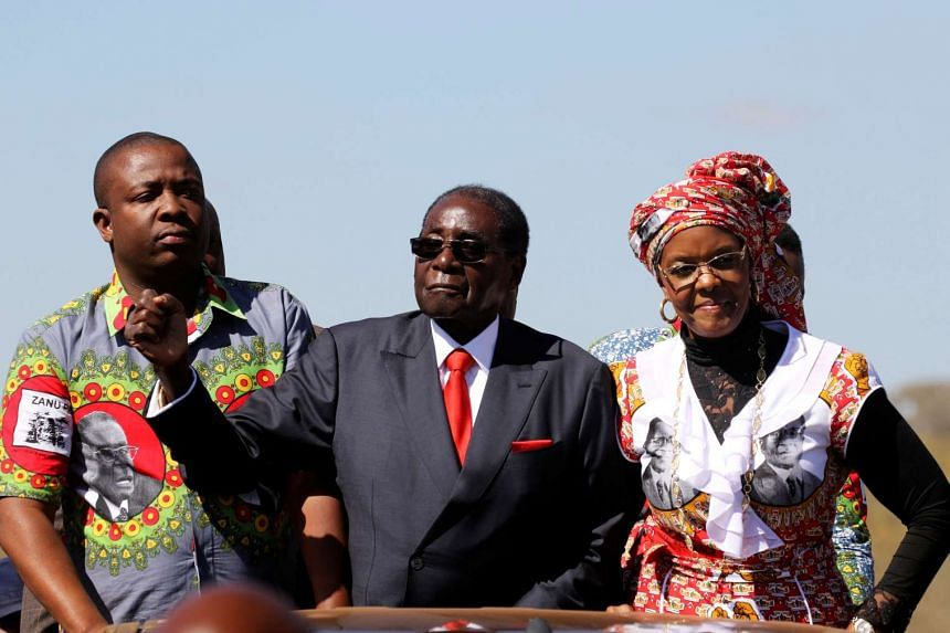 """Zimbabwe's President Robert Mugabe and his wife Grace greet supporters of his ZANU (PF) party during the """"One Million Man March""""on May 25. 2016."""