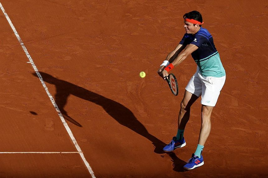 Canadian Milos Raonic playing against Frenchman Adrian Mannarino at the French Open on May 25.
