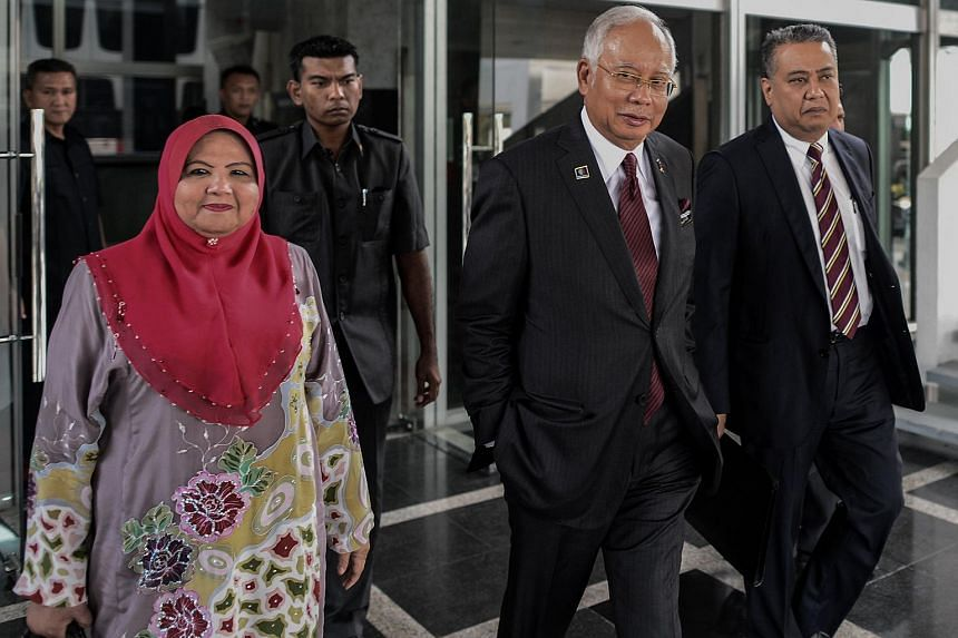 Malaysia's Prime Minister Najib Razak (second from right) leaves his office at the parliament in Kuala Lumpur on May 25, 2016.