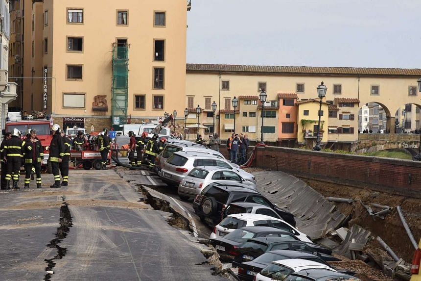 A stretch of road between the 14th century Ponte Vecchio (above) and the Ponte alle Grazie caved in when a mains pipe it was sitting on burst.