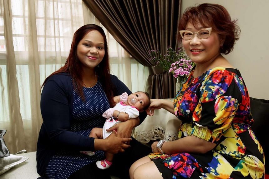 Ms Nurhayati (left, with her daughter Amelia Isha Sharma) still keeps in touch with former mentor Ms Wong even though the mentorship ended more than four years ago.