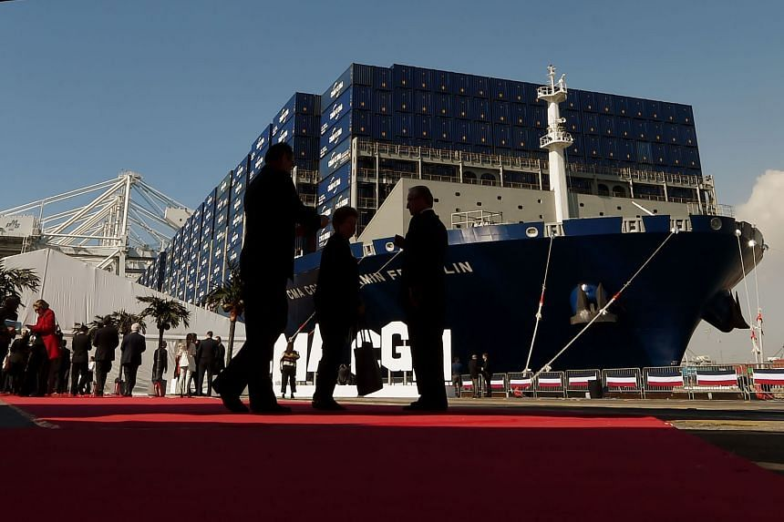 A photo taken in February of CMA CGM's mega-cargo ship, Benjamin Franklin, before its inauguration ceremony at Long Beach, California. The NOL acquisition will bring CMA CGM's fleet to 563 vessels, up from 469.