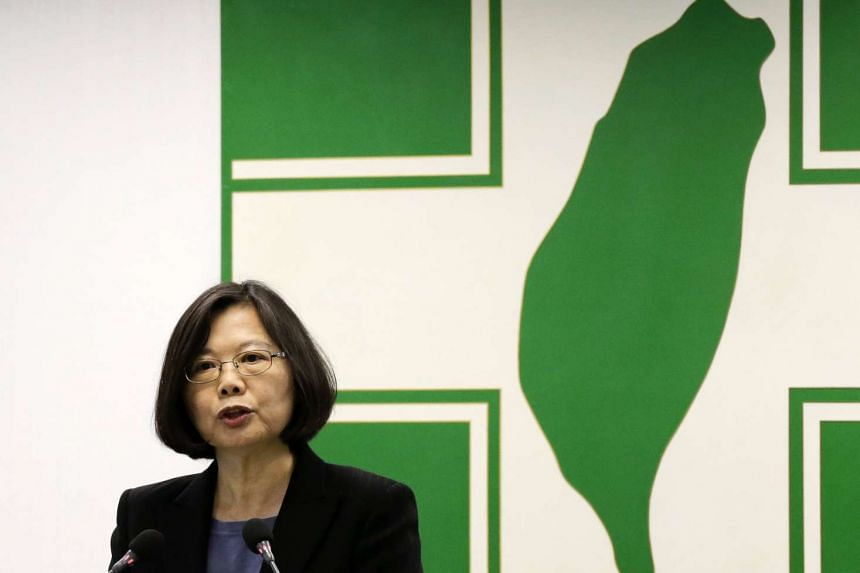 Taiwan President Tsai Ing-wen speaks in front of the Democratic Progressive Party (DPP) logo before their party meeting in Taipei.