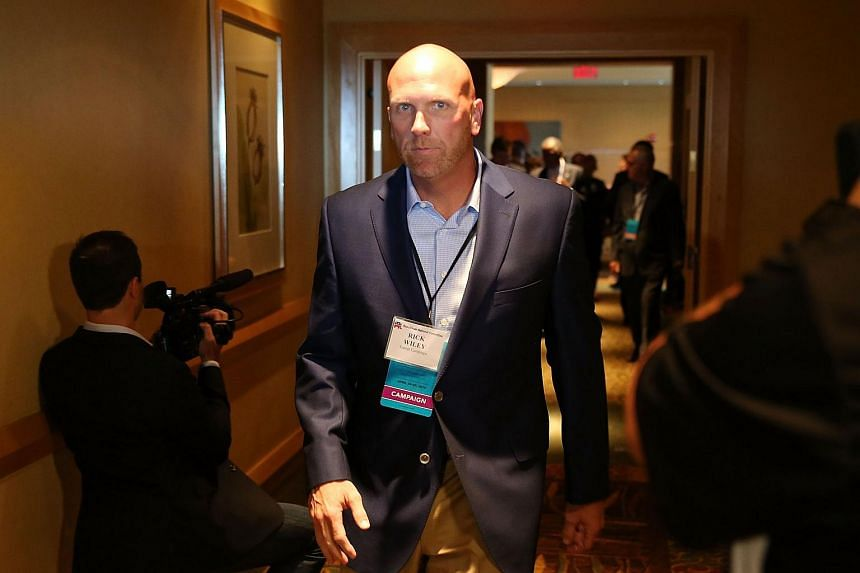 Donald Trump's national political director Rick Wiley arrives for a Trump for President reception.