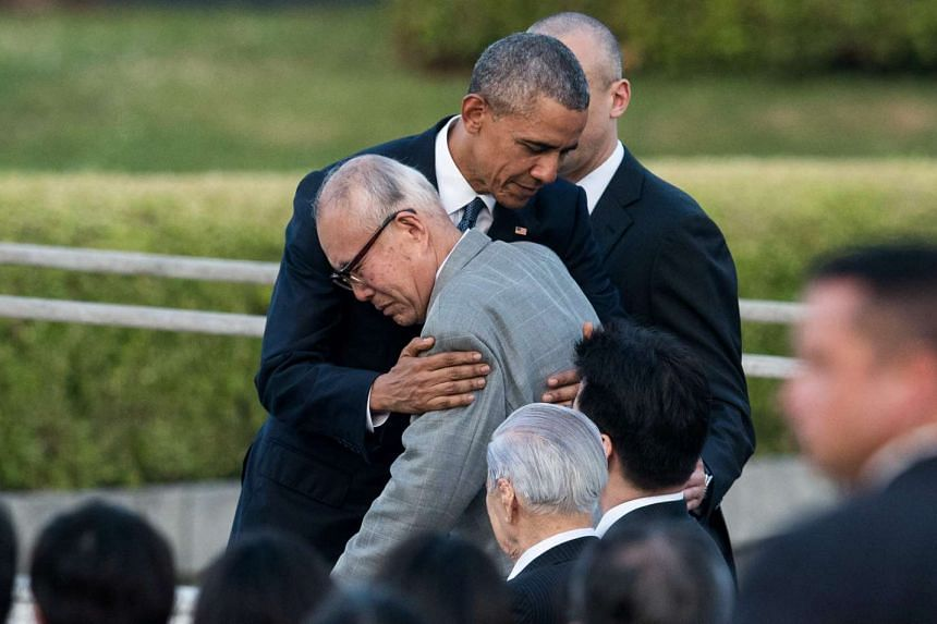 US President Barack Obama hugs a survivor of the atomic bombing of Hiroshima at the Hiroshima Peace Memorial Park cenotaph in Hiroshim,a on May 27, 2016.