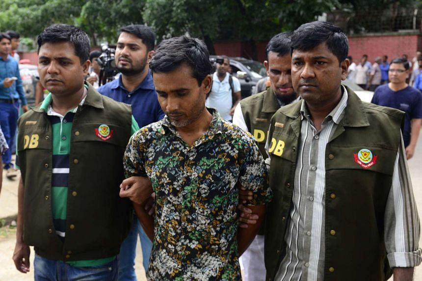 Bangladesh police arrest suspected Islamic militant Shariful Islam Shihab (centre) over the hacking to death of two gay rights activists in Dhaka, on May 15, 2016.