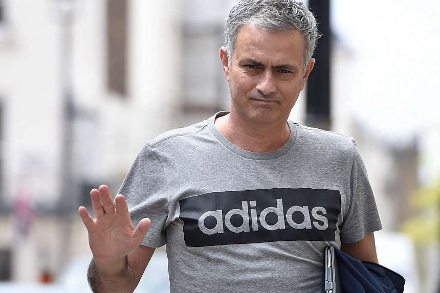 Jose Mourinho gestures as he walks towards his house in London, Britain, on May 27, 2016.