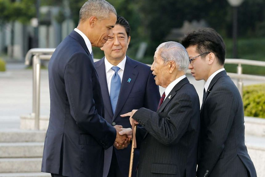 US President Barack Obama (left) talks with 91-year-old A-bomb survivor Sunao Tsuboi (second from right) at Hiroshima Peace Memorial Park, on May 27, 2016.