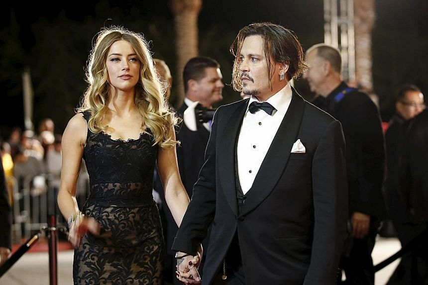 Johnny Depp and his wife Amber Heard at the Palm Springs International Film Festival in January this year.