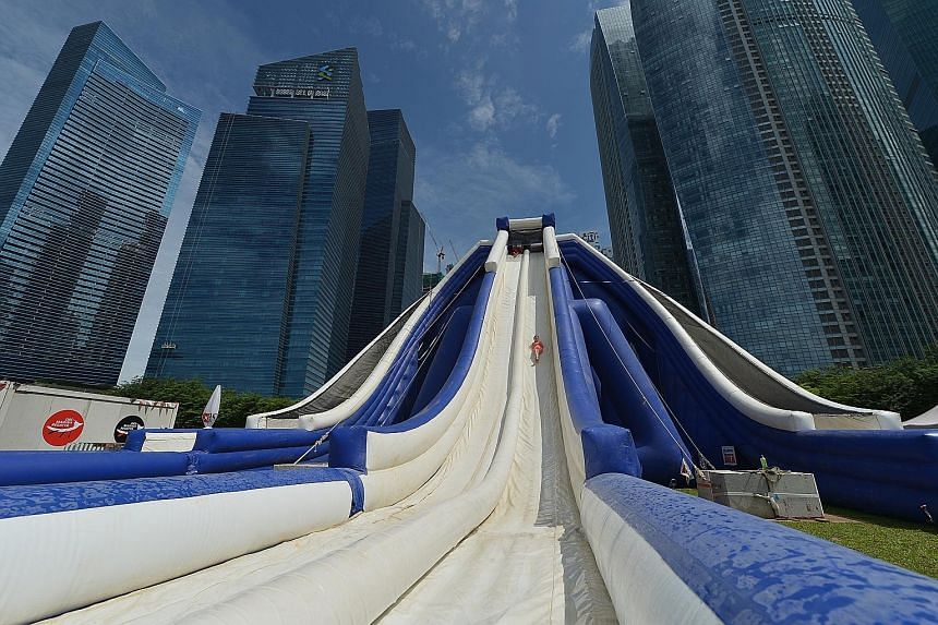 Up to four people can ride the 16m-high inflatable slide at a time at the DBS Marina Regatta.