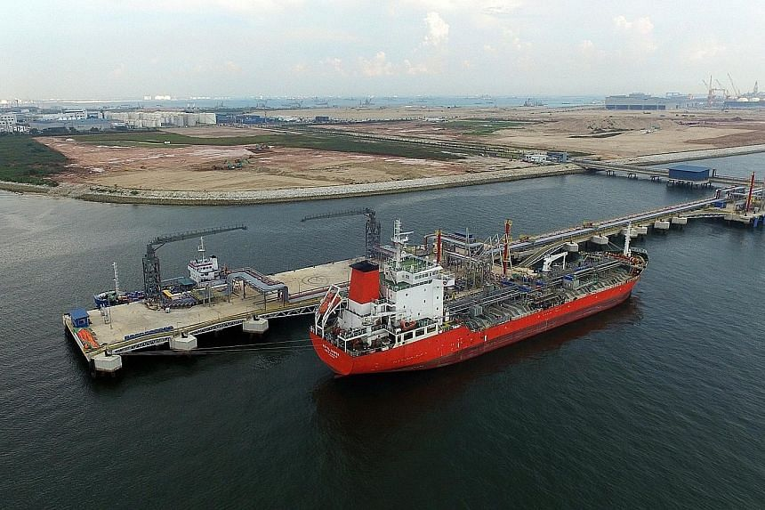 The Singapore Lube Park in Tuas houses shared facilities such as an import-export jetty (above), pipelines and a tank farm (left).