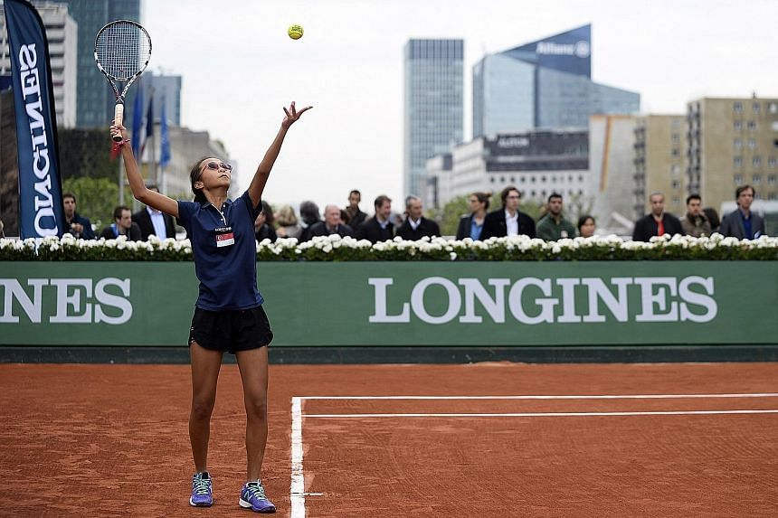 Alexis Tan serving against her opponent Nikki Yanez at the Longines Future Tennis Aces tournament in Paris. With her first forays into competitive tennis, the Singaporean has been rubbing shoulders with the who's who of tennis.