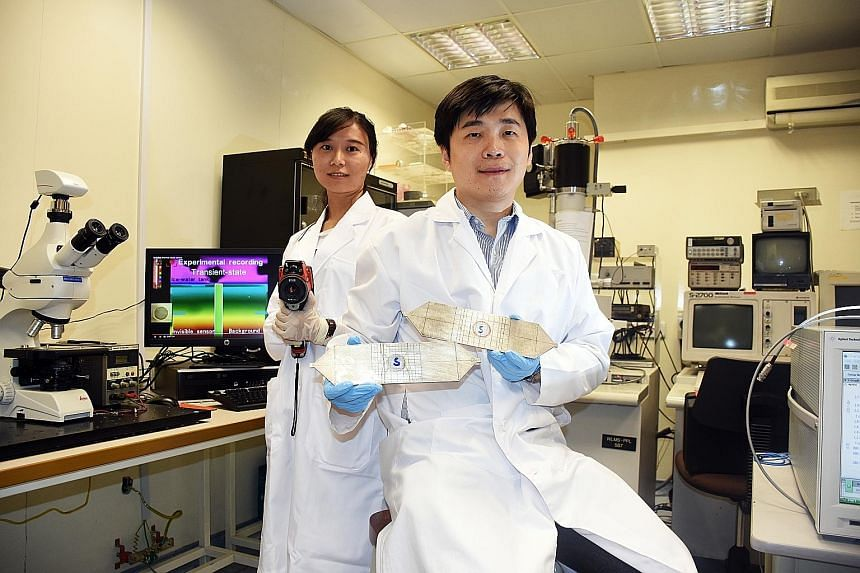 Left: Prof Qiu (with pieces coated with the shell material) and PhD student Xue Bai. Above: A sensor coated with the shell material is placed between a cold water tank and a heated plate. The sensor's thermal energy is hidden due to the shell, which