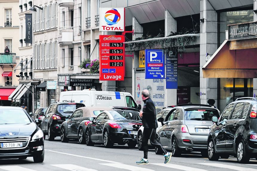 Drivers forming a queue yesterday at a petrol station in Paris amid blockades of several oil depots by protesters opposed to labour law reforms that make it easier to hire and fire workers.