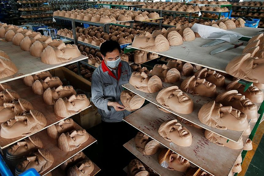 A worker checking a mask of United States Republican presidential candidate Donald Trump at a factory in China's Zhejiang province on Wednesday. The factory, which produces thousands of rubber and plastic masks of everyone from Osama bin Laden to Spi