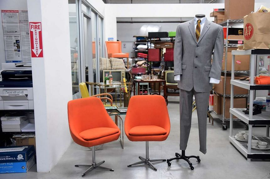 A Lane Price suit and a pair of Don Draper chairs, among other items.