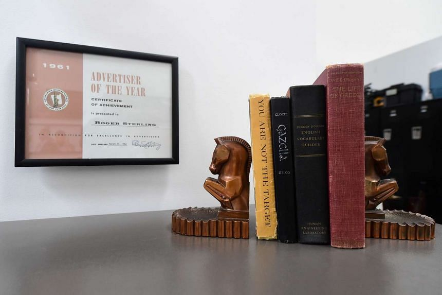 A Roger Sterling certificate and Don Draper's books and bookends.