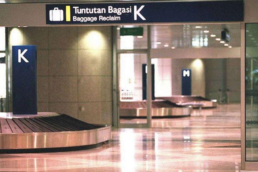 Baggage carousel at Kuala Lumpur International Airport.