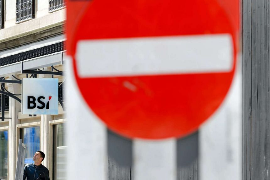 The sign of Swiss bank BSI is seen outside a subsidiary on May 24, 2016 in Geneva.