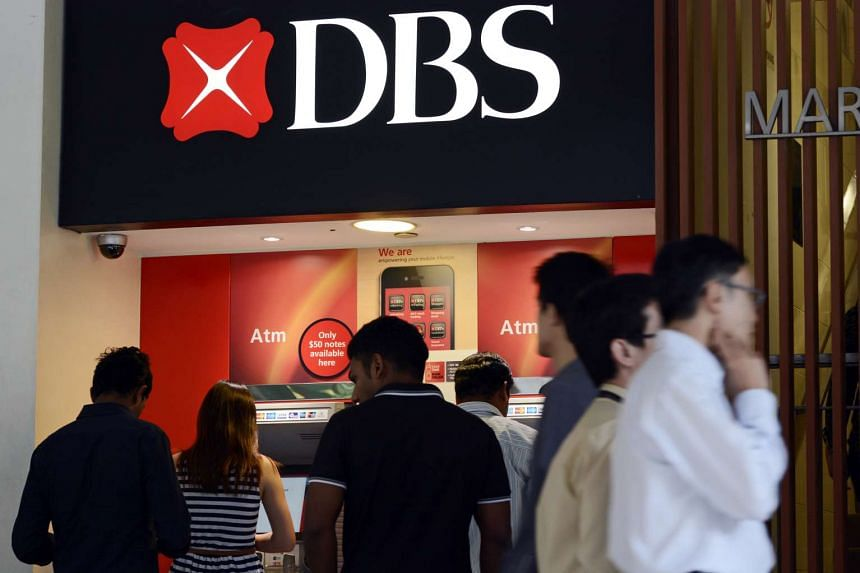 Customers use DBS Group Holdings Ltd ATMs in Singapore.