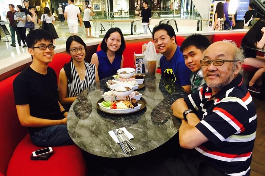 Ms Wang Jiehui, a subject head at Millennia Institute (third from left), having a meal with her family on Eat With Your Family Day on Friday (May 27) at Ion Orchard's Haagen-Dazs outlet.