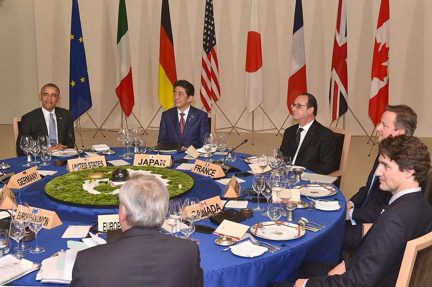 (From left) US President Barack Obama, Japanese Prime Minister Shinzo Abe, French President Francois Hollande, British Prime Minister David Cameron and Canadian Prime Minister Justin Trudeau on the first day of the G-7 leaders summit.