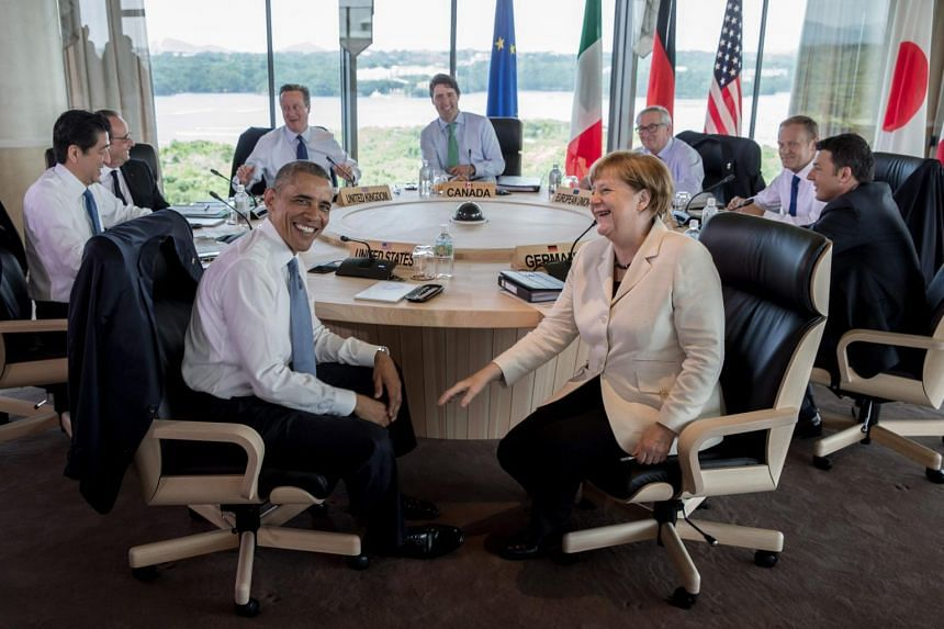 German Chancellor Angela Merkel (centre) speaks with US President Barack Obama (centre, left) during a meeting at the G7 summit in Japan, May 27. (From left to right) Japanese Prime Minister Shinzo Abe, French President Francois Hollande, British Pri