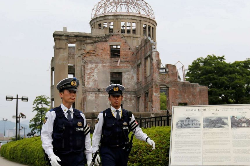 Police officers in front of the Atomic Bomb Dome at Peace Memorial Park in Hiroshima, Japan, on May 27, 2016.