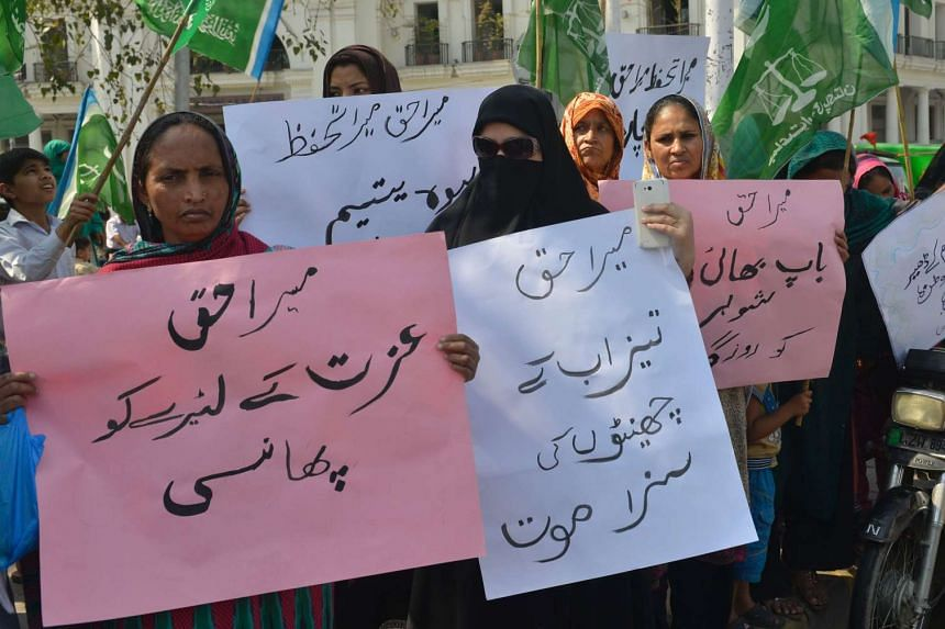 Supporters of Pakistan's Islamist party Jamaat-e-Islami (JI) hold placards during a rally to mark International Women's Day in Lahore, on March 8, 2016.