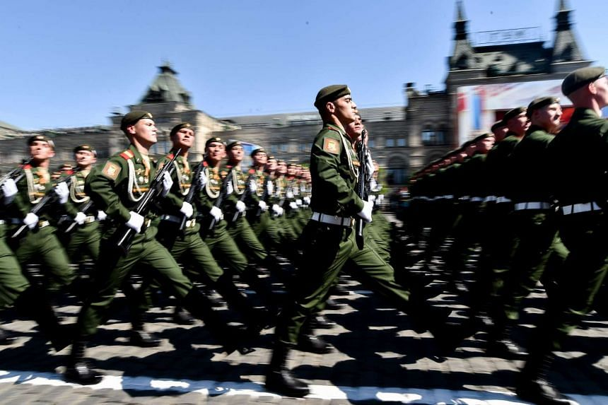 Russian servicemen march at Red Square during the Victory Day military parade in Moscow on May 9, 2016.