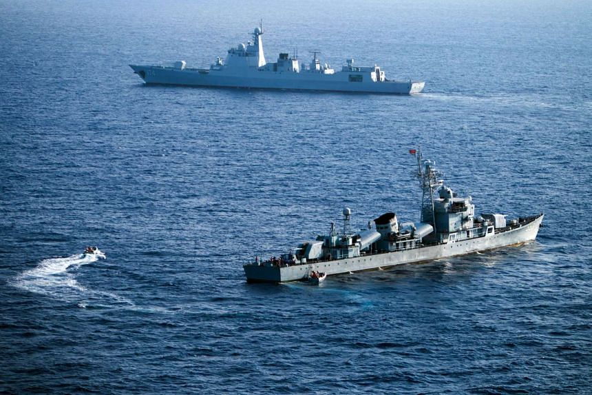 Crew members of China's South Sea Fleet taking part in a drill in the Xisha Islands, or the Paracel Islands, in the South China Sea, on May 5, 2016.