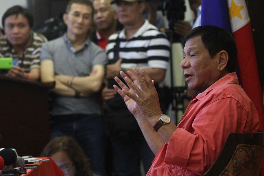 Philippine President-elect Rodrigo Duterte gestures at a news conference in Davao city, southern Philippines, on May 26, 2016.