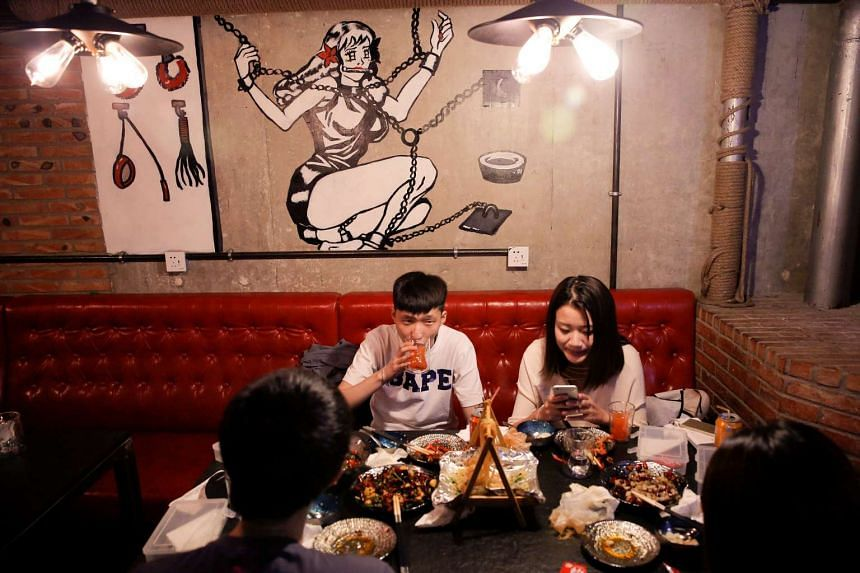 Customers eat a meal at Ke'er restaurant (Shell in English) in Beijing, China, on May 26, 2016.