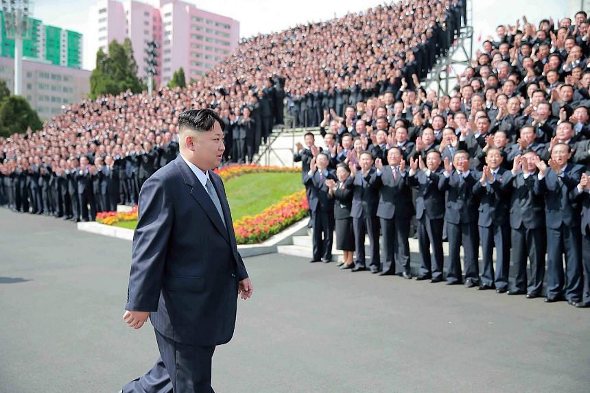 North Korean leader Kim Jong Un (centre) attending a photo session with the participants of the Seventh Congress of the Workers' Party of Korea at an undisclosed location.