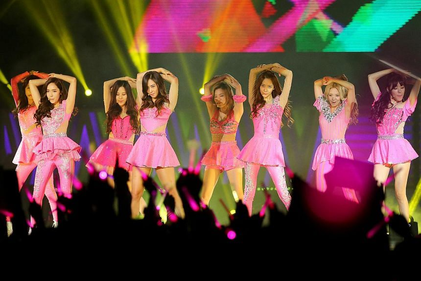 K-pop group Girls' Generation performing at the Singapore Indoor Stadium in 2013.