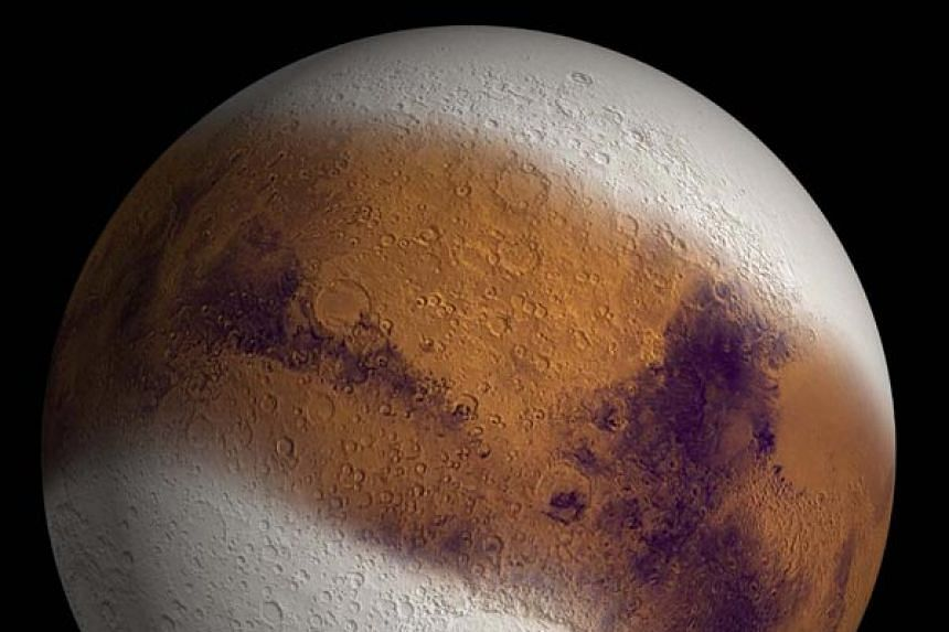 A simulated view shows Mars as it might have appeared during the height of a possible ice age.