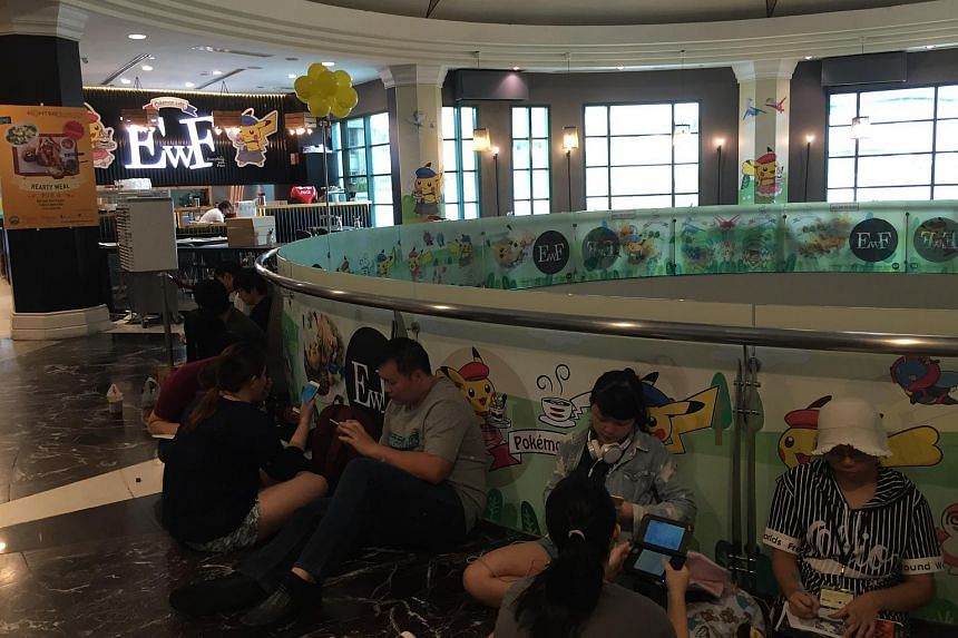 People in the queue before the opening of Singapore's first Pokemon cafe at Bugis Junction on Friday (May 27) morning.