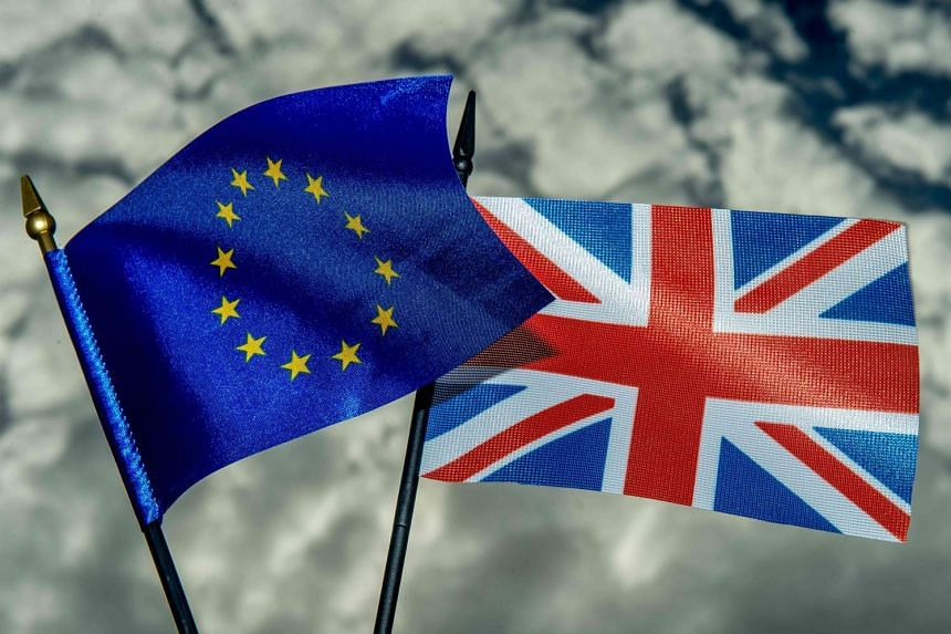 A photo illustration shows the flags of the European Union and the United Kingdom.