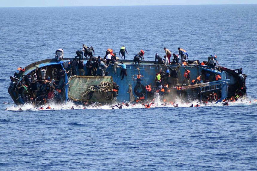 Dramatic images released by the Italian navy show how the overcrowded fishing vessel overturned off the Libyan coast on Wednesday.