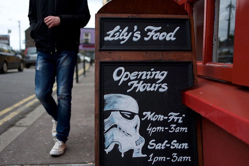 A tourist walking past the drawing of a Star Wars stormtrooper on a restaurant's signboard in Dingle, Ireland, on May 23.